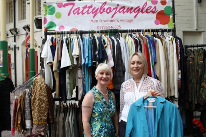 Purchasing my new duster coat from Linda Turner Brown, owner of Tattybojangles