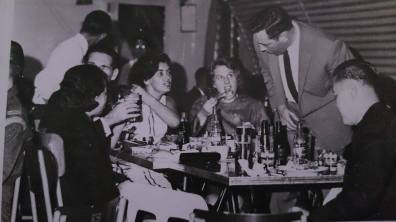 Margot's parents (centre, seated) with friends in the early 60s