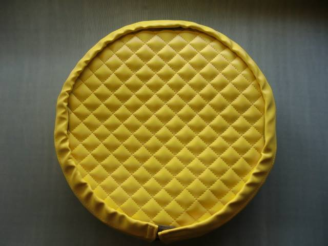 The spare wheel cover includes a seperate quilted panel, which encloses the spare, hiding it from view