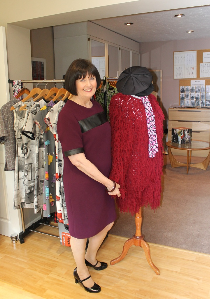 Gill, surrounded by some of her designs in the ModTogs workshop